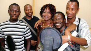 Burkina Faso actors behind the microphones, smiling in the studio